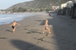 The kids running from the waves